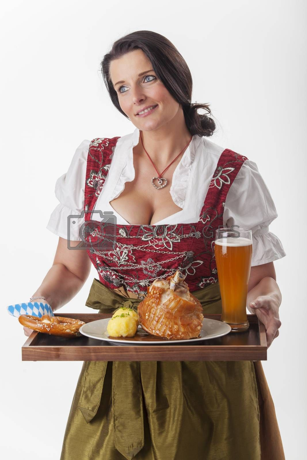 bavarian woman in a dirndl serving food