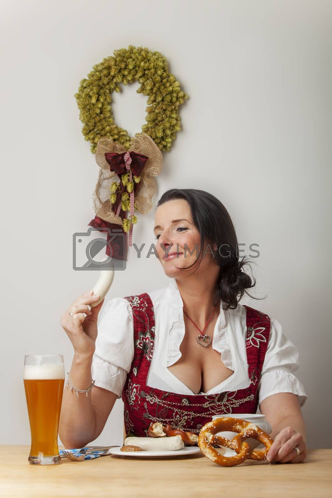 bavarian woman in a dirndl eating