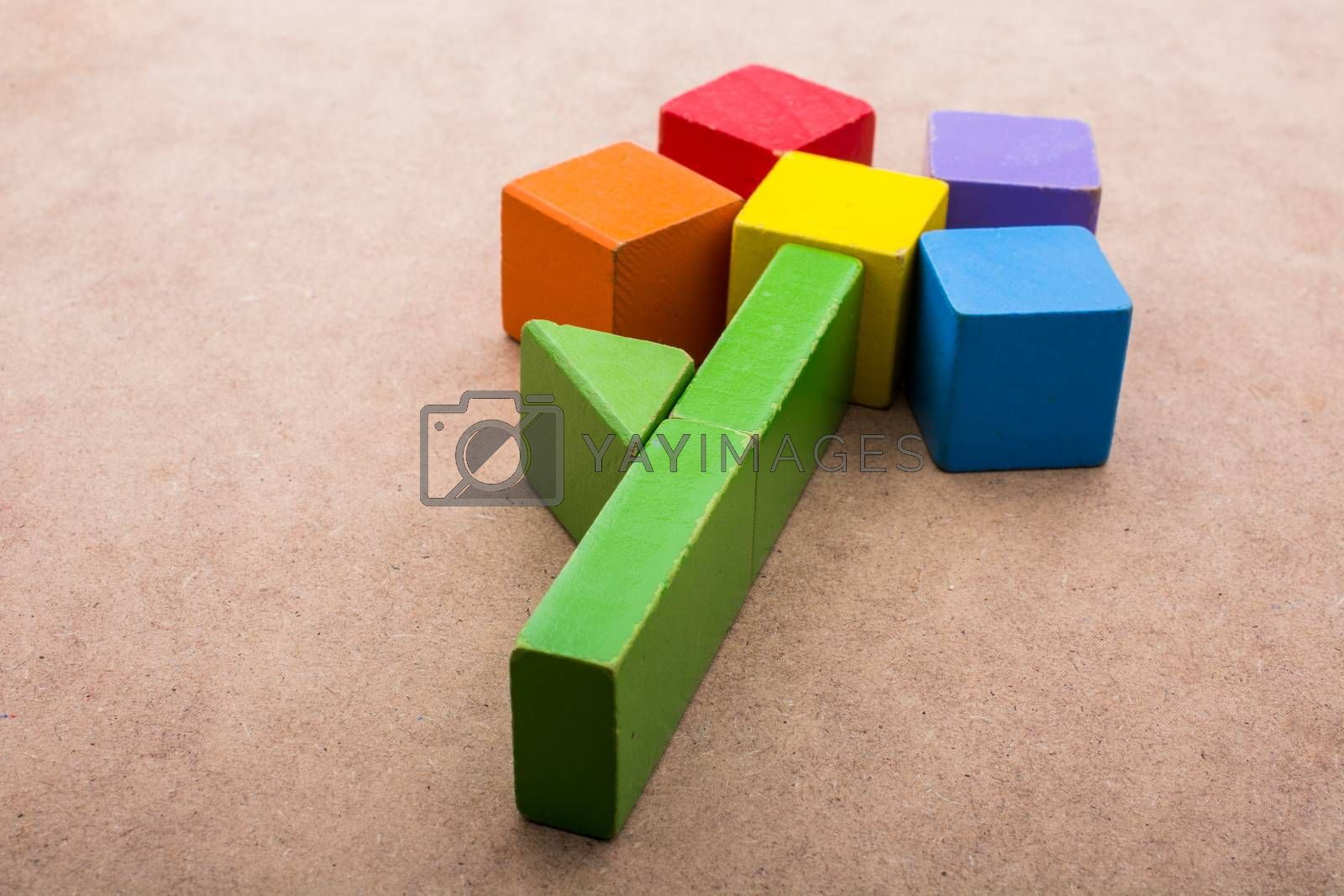 Colorful building  blocks form a flower on a brown background