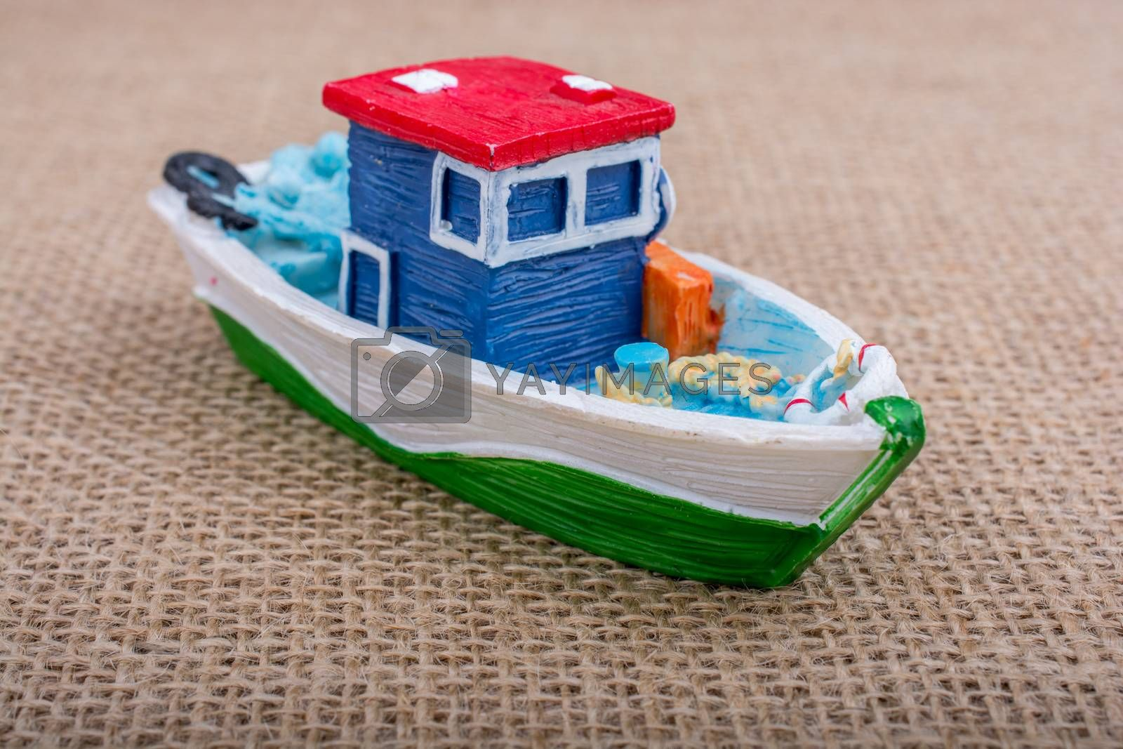 Hand made sail boat on canvas with figurine on