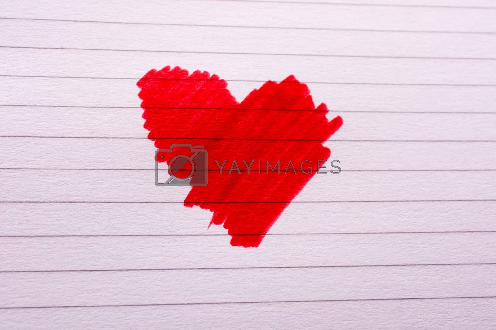 Red heart on a lined notebook
