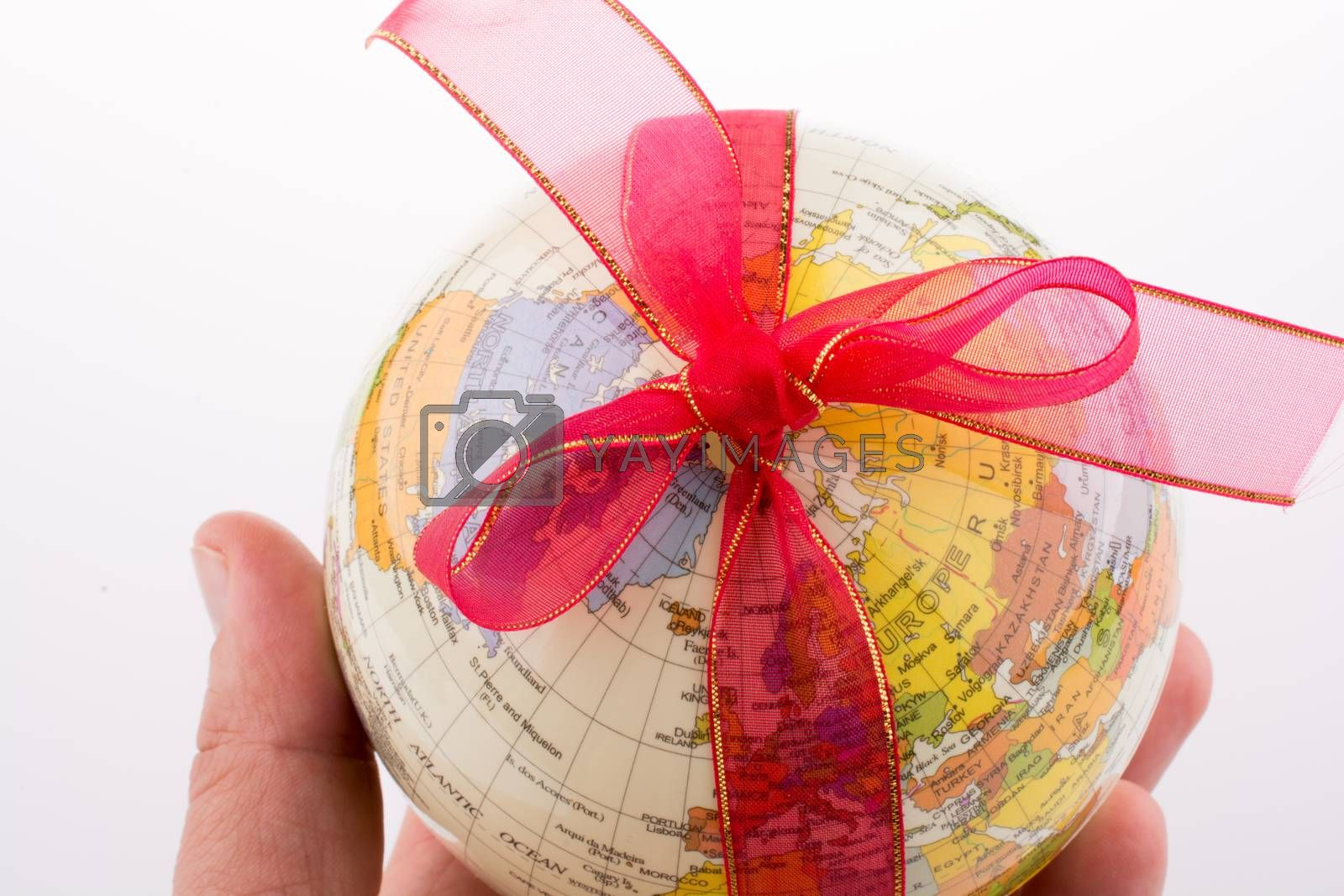 Globe tied with red ribbon on a white background