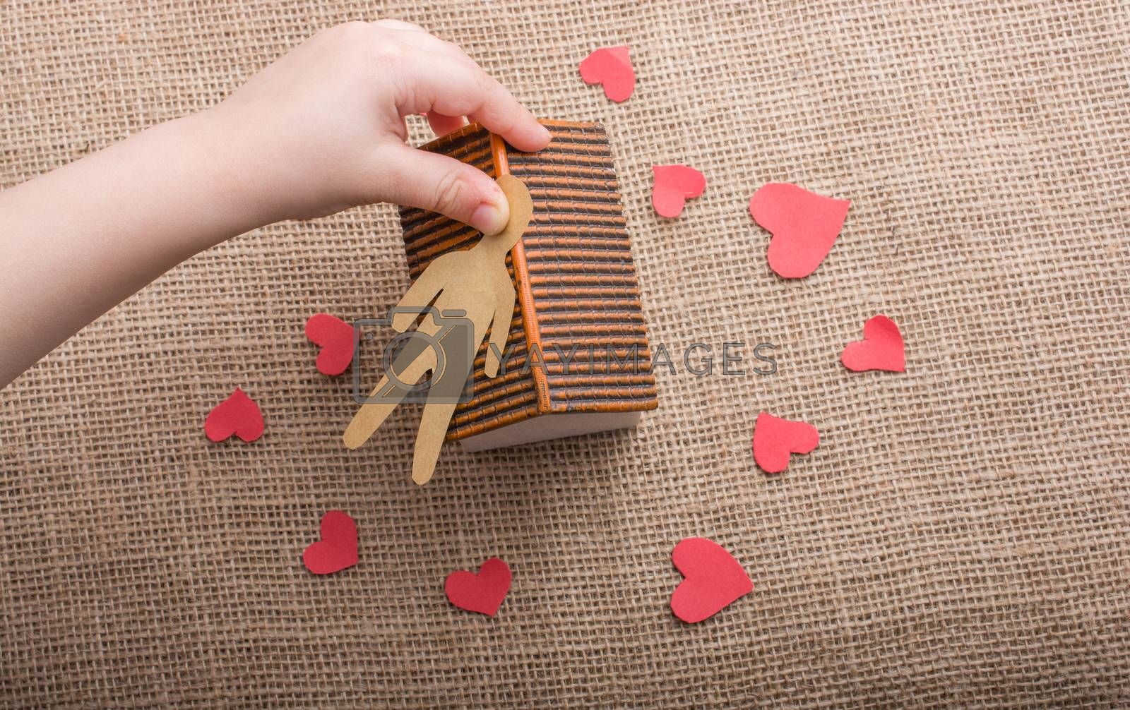 Heart shaped icons and paper house on canvas