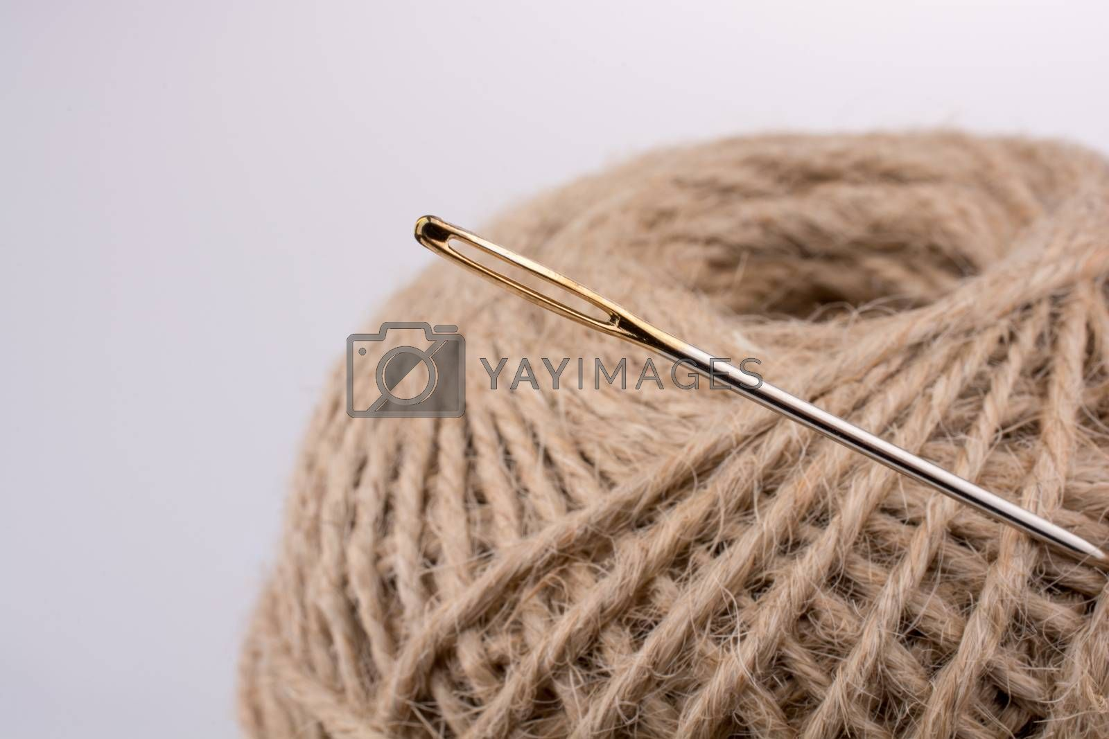 Needle on the spools of thread isolated on white background