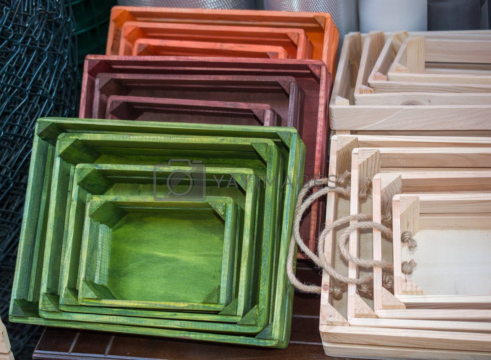 Colorful wooden crate boxes for sale in a market