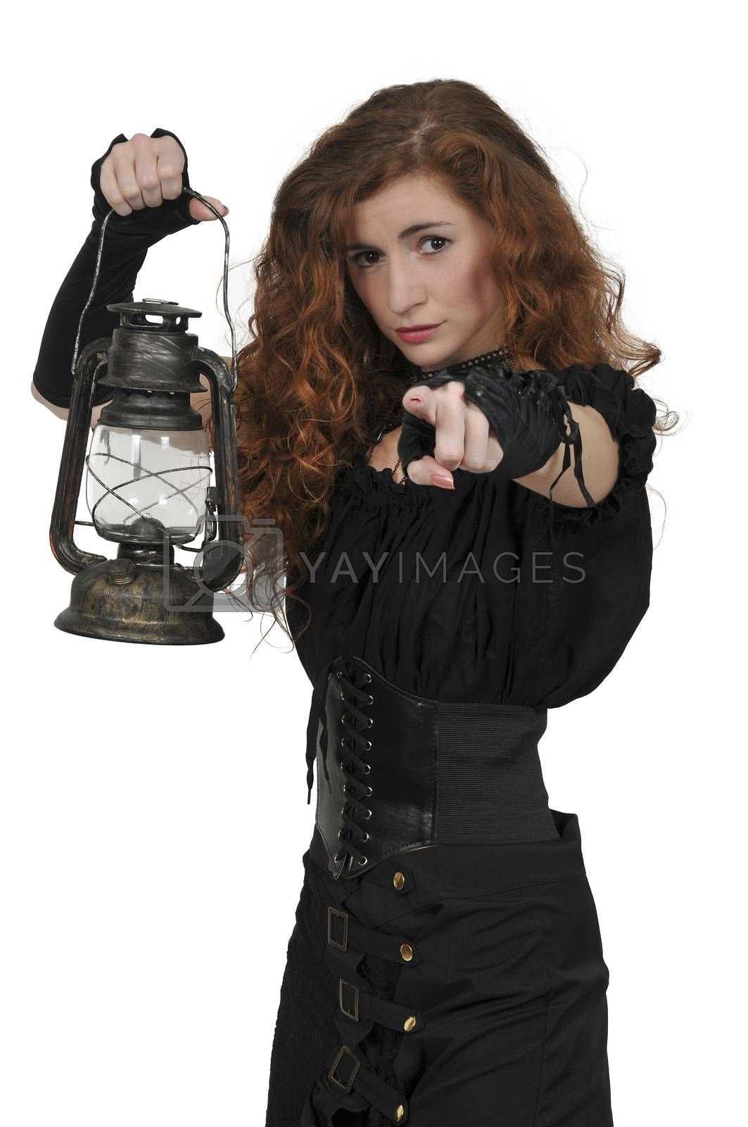 Woman looking with an old fashoned lantern