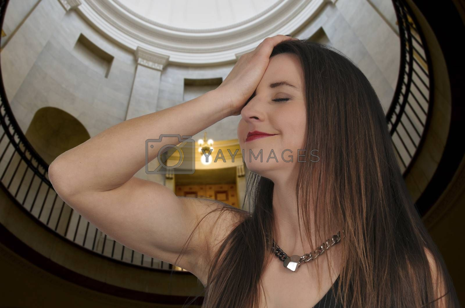 Beautiful forgetful woman with her hand face palming on her forehead