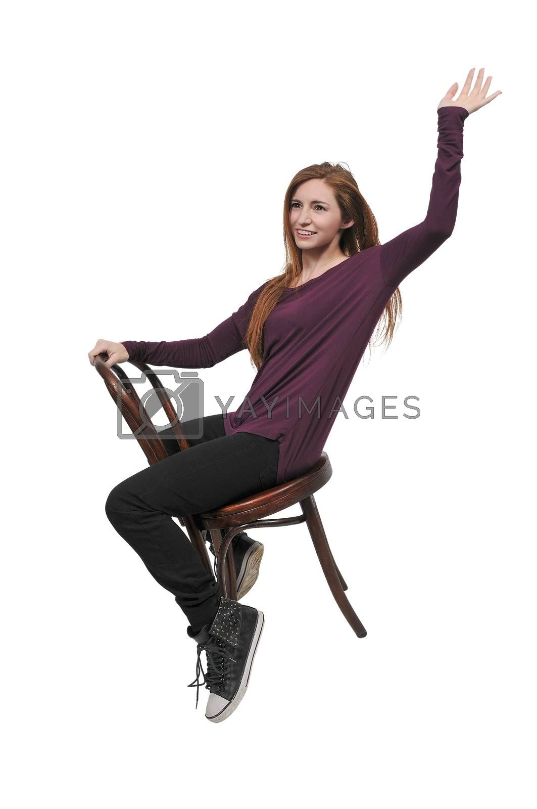 Young Beautiful Woman sitting in a chair