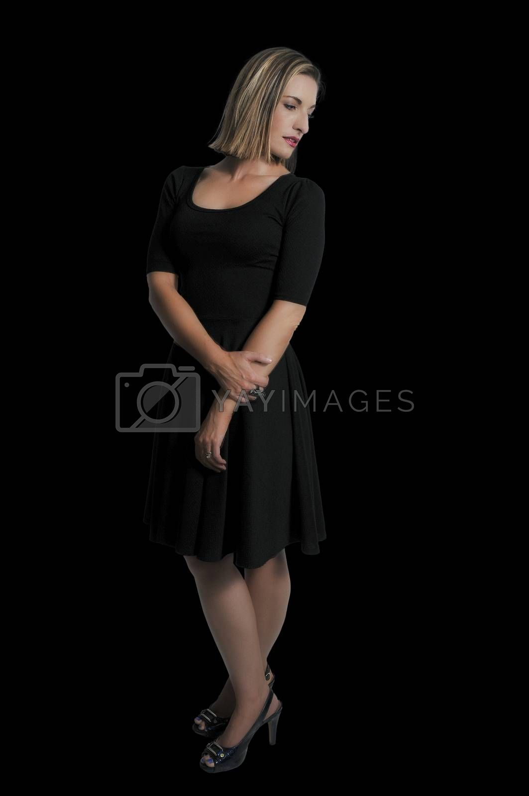 Beautiful young sexy woman in a little black dress