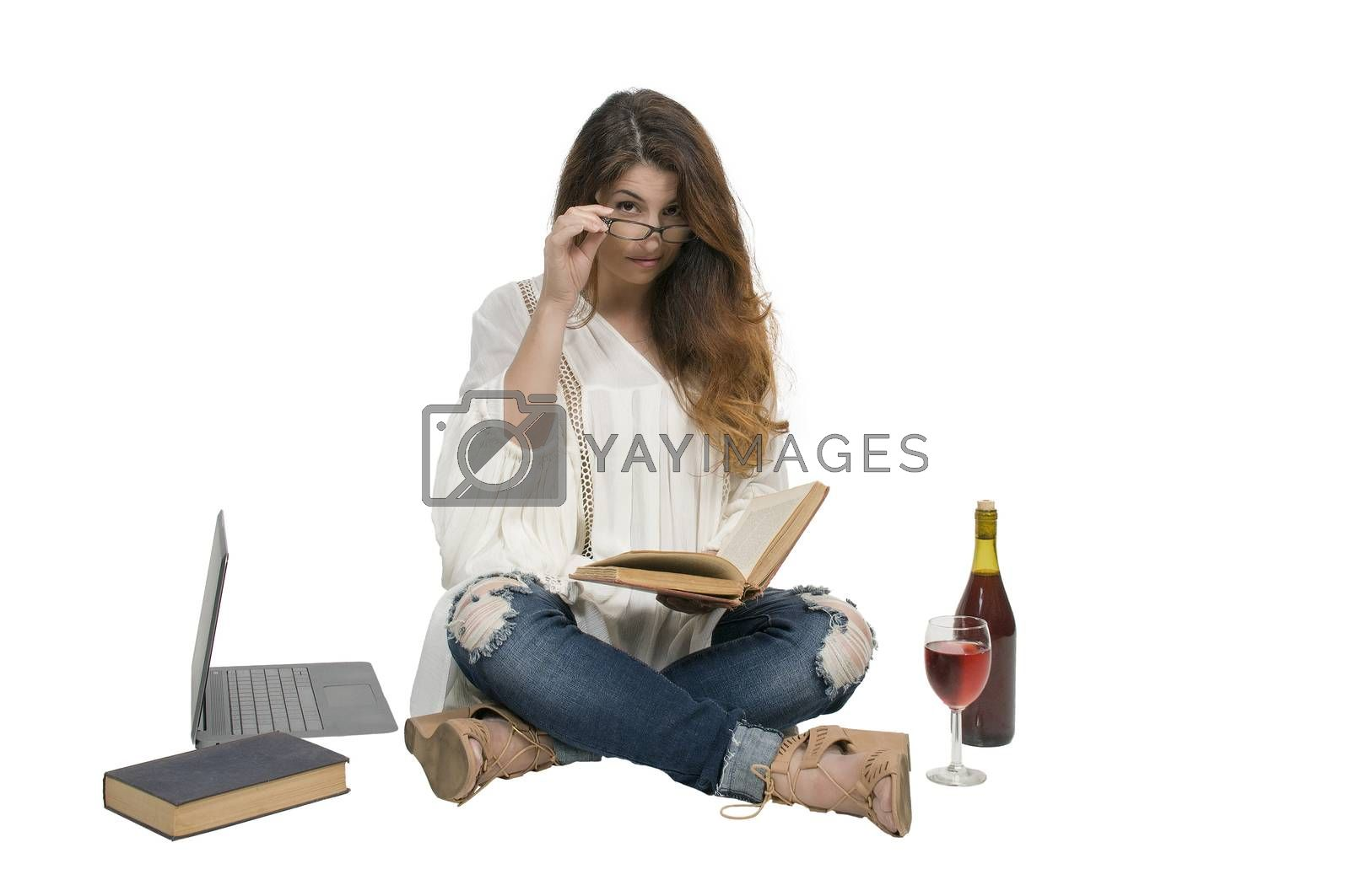 Beautiful young woman reading an interesting book