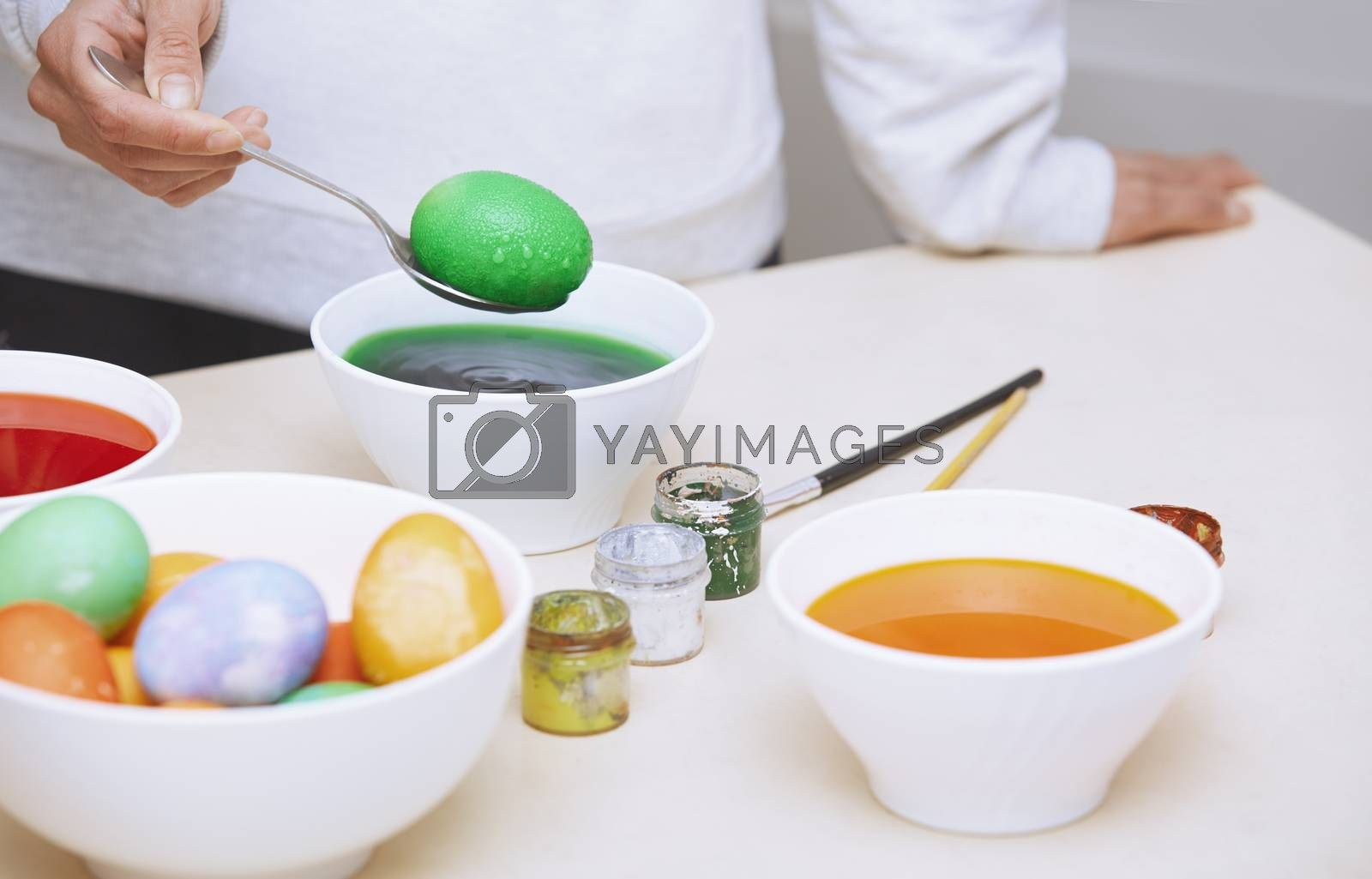 Woman preparing Easter eggs