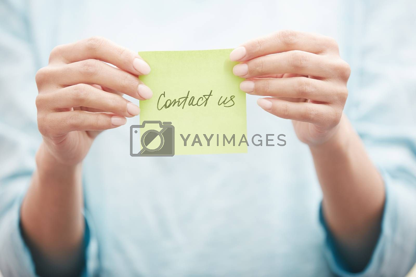Yoga instructor holding sticky note with Contact us text