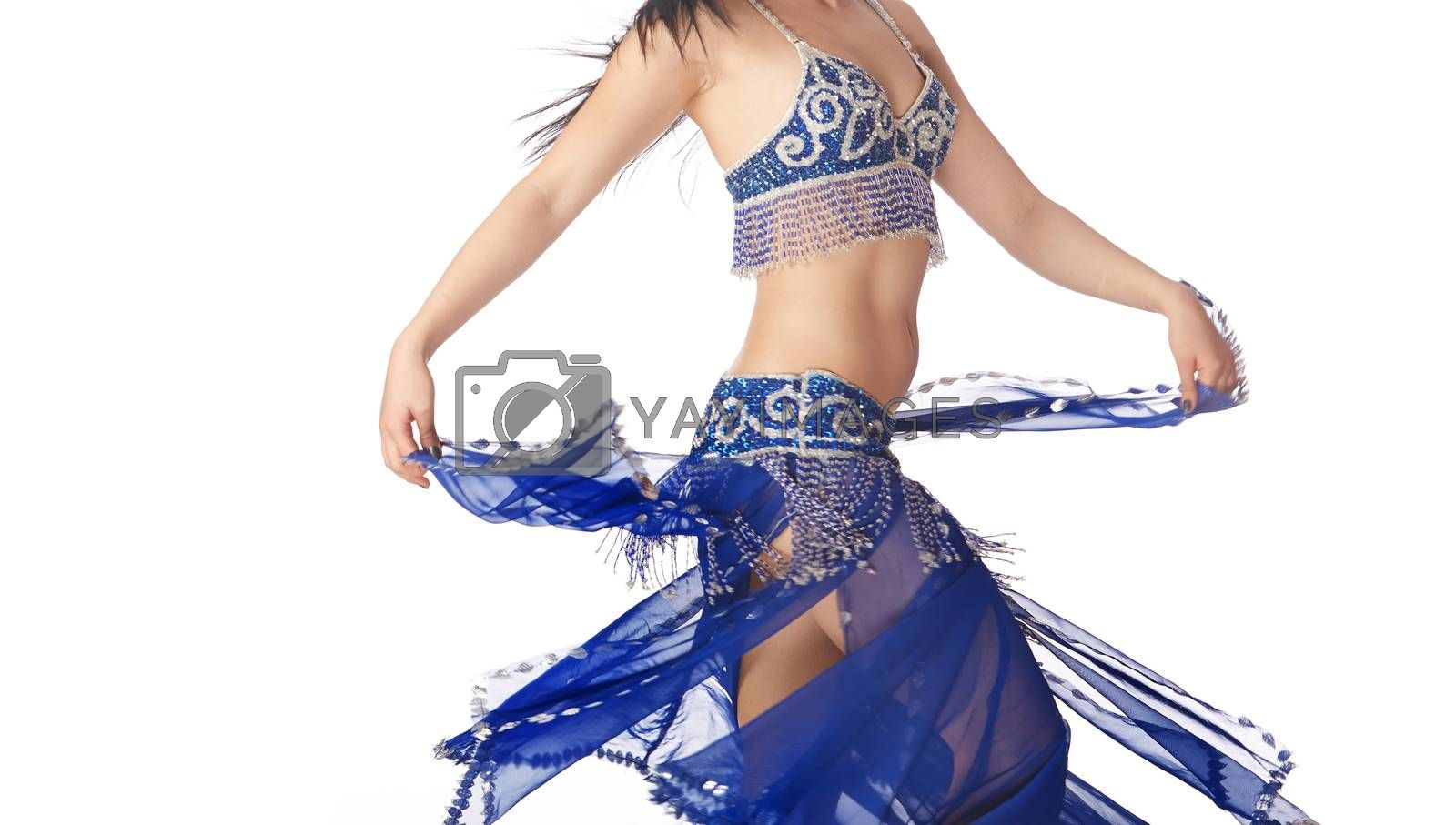 Belly dancer in blue traditional dress on a white background