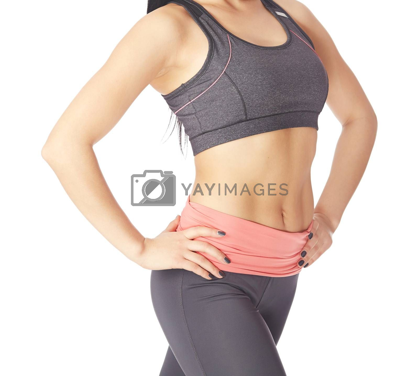 Fitness woman posing on a white studio background