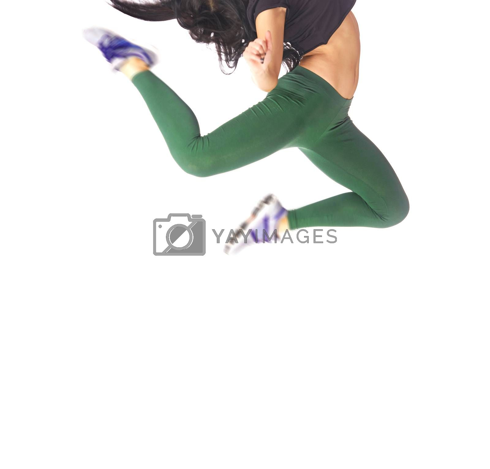 Woman jumping and dancing on a white background in studio