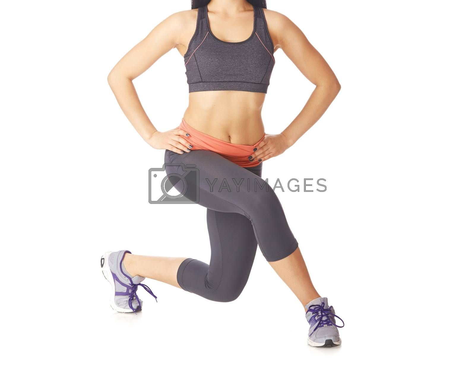 Woman doing fitness exercise on a white studio background