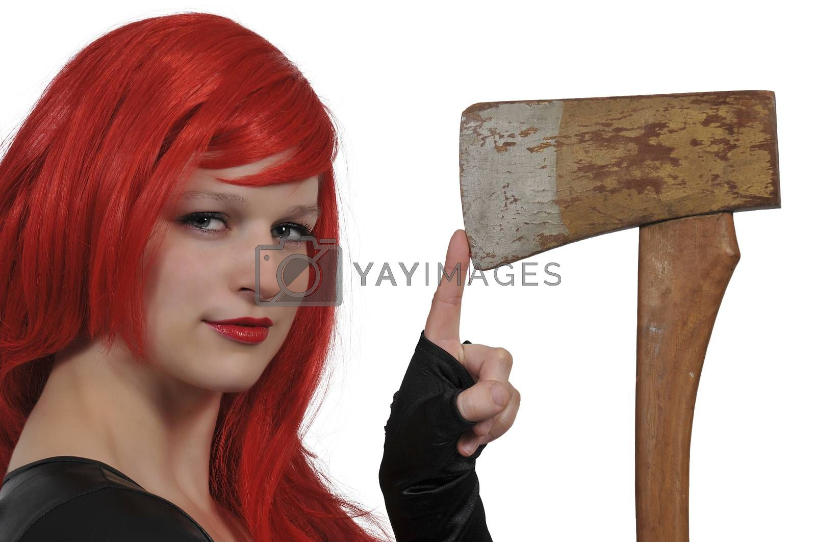 Beautiful young woman holding a wooden handled axe