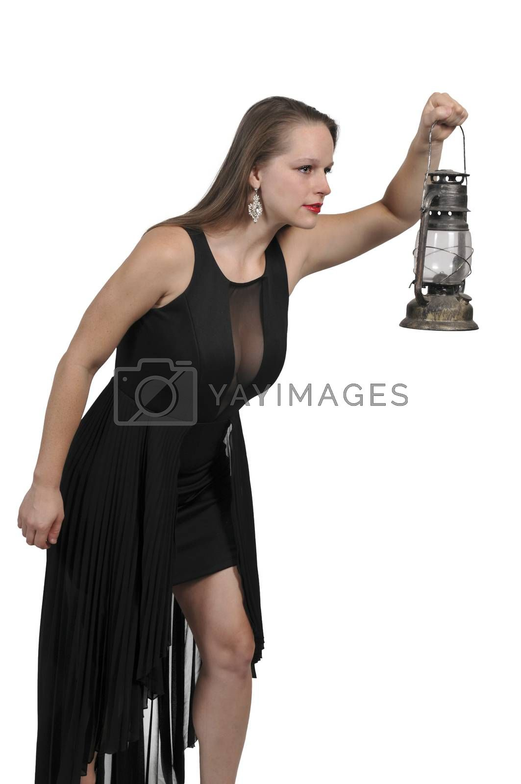 Woman looking with an old fashioned lantern