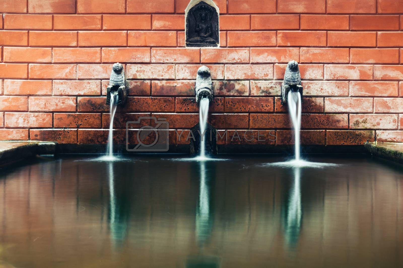 Long exposure of a traditional fountain in Kathmandu, Nepal