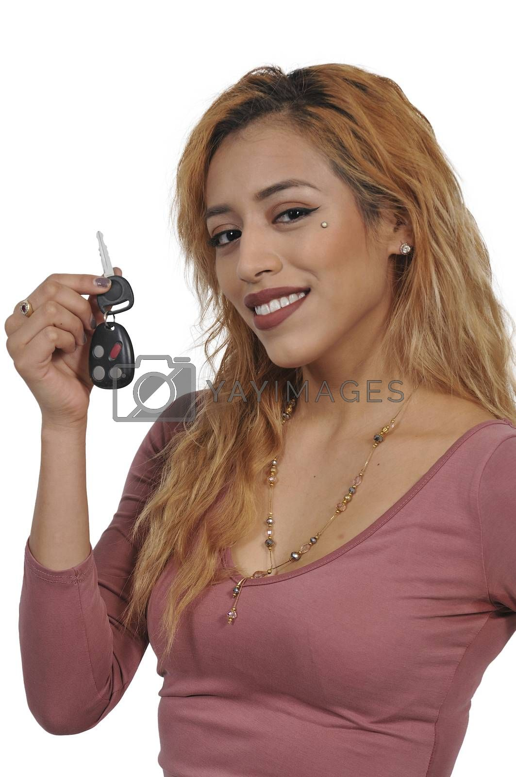 Woman holding keys to a new car