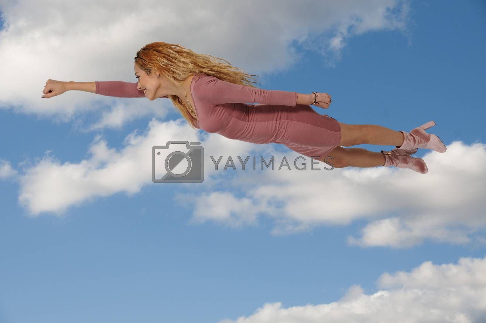 Beautiful young woman flying or falling through the air