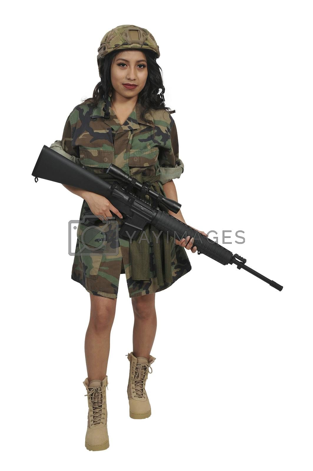 Beautiful young woman soldier with an assault rifle