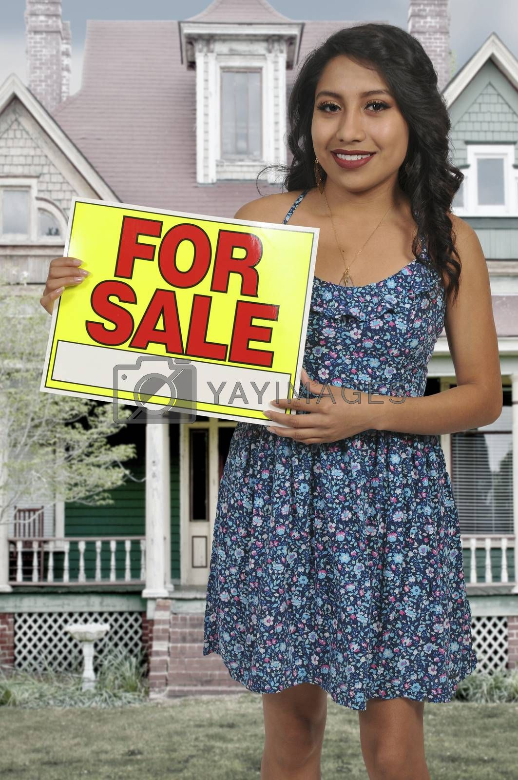 Woman holding for sale sign by robeo