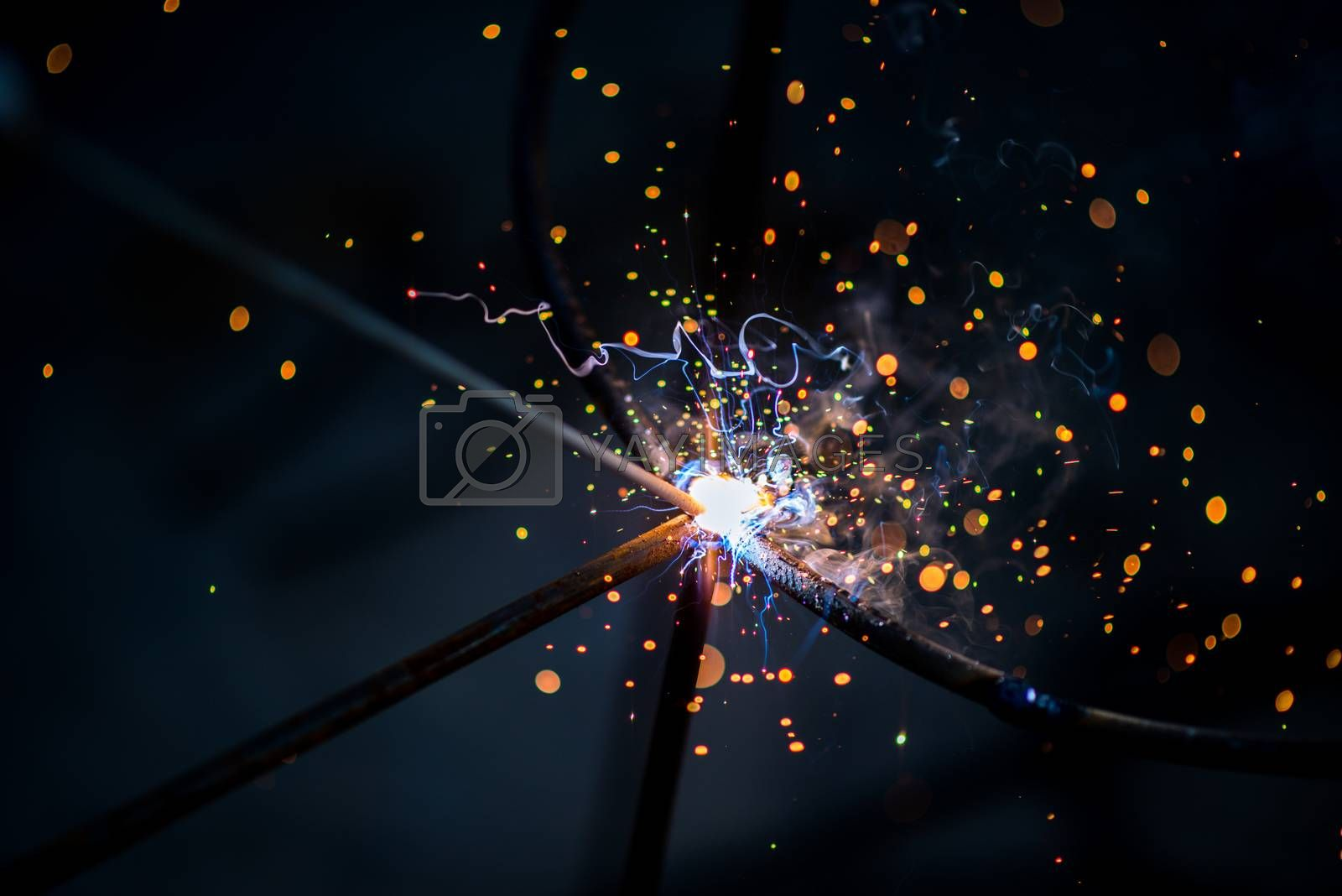 Royalty free image of electric sparklers of steel welding by antpkr