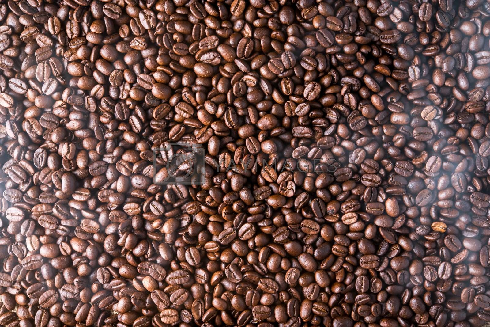 top view of roasted coffee beans background with smoke