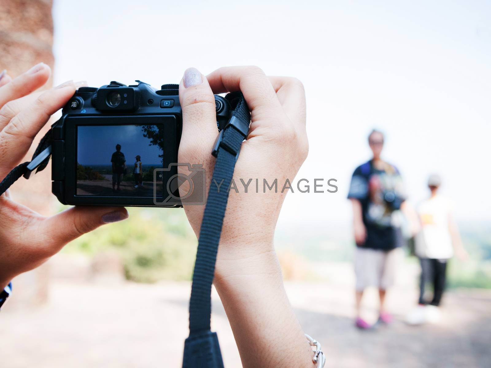 hand holding of camera take a photo, travel conception