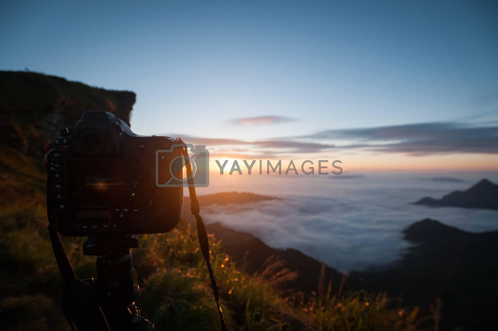 Camera take a photo of sunrise view landscape, Traveler conception.