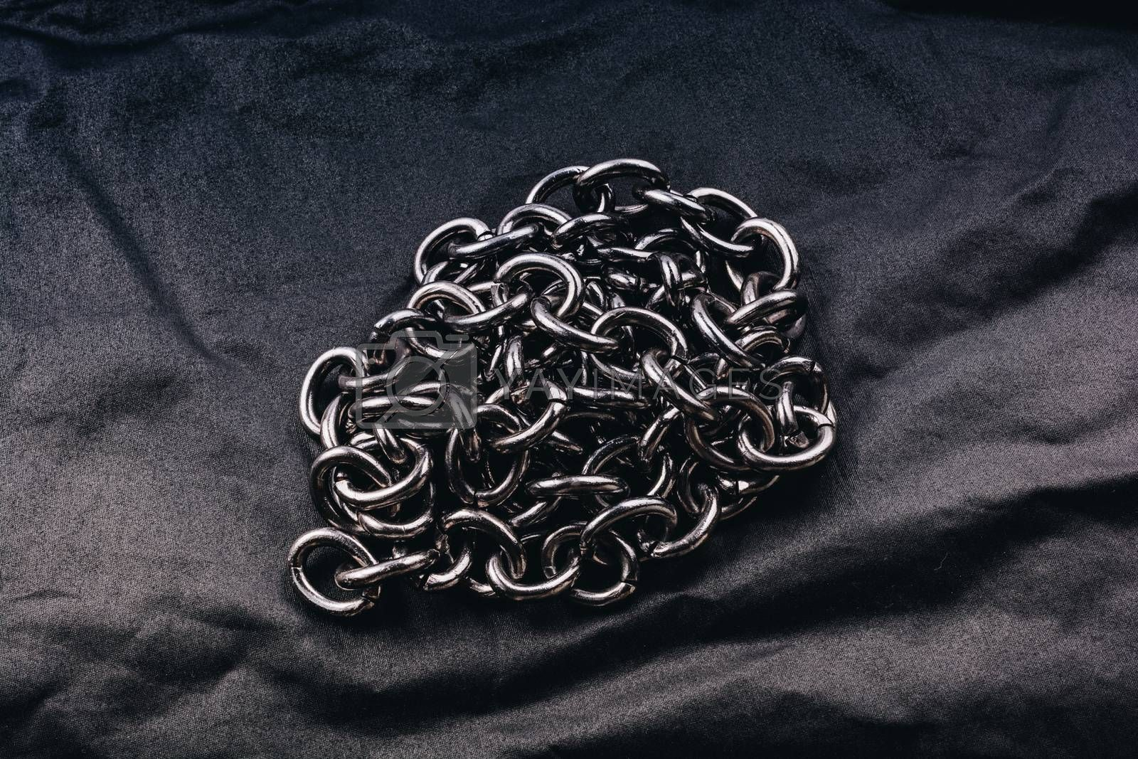 Roll of new metal chain found on the background
