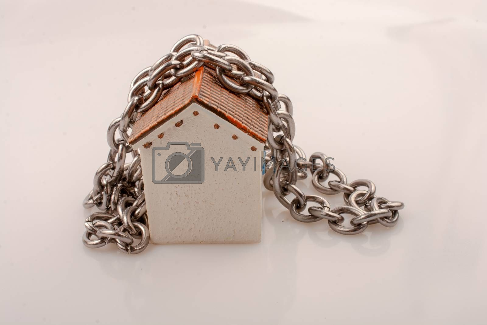 Chain around a little model house in the view