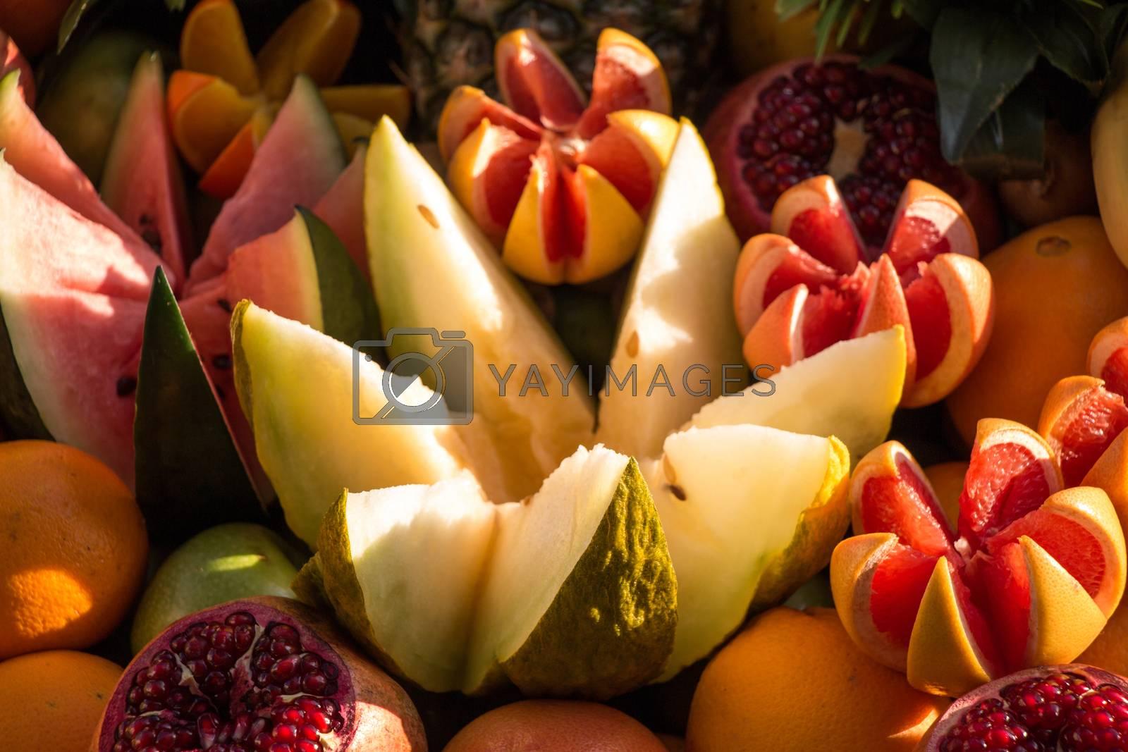 Grapefruits, mangoes, pomegranates, oranges, bananas, kiwis and melons