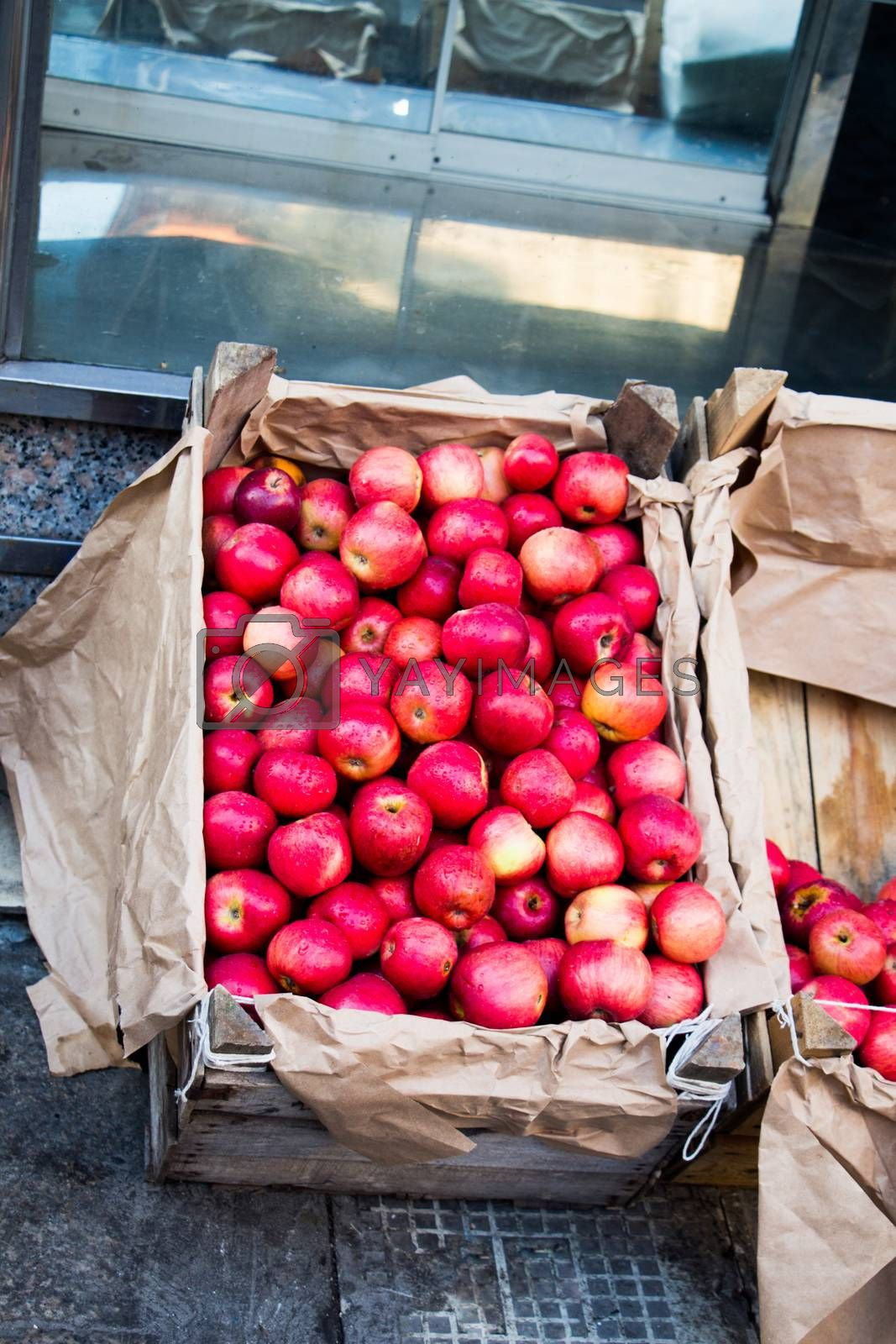Red apples in box crate baskets