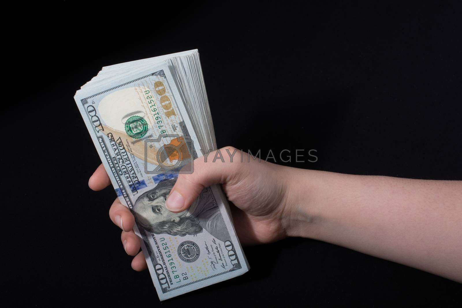 Hand holding American dollar  banknotes isolated on white background