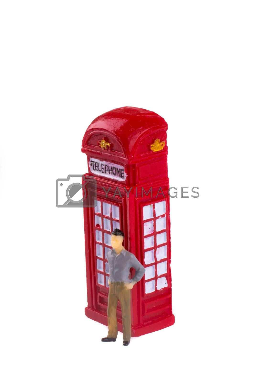 Model man standing by the telephone booth on a white background