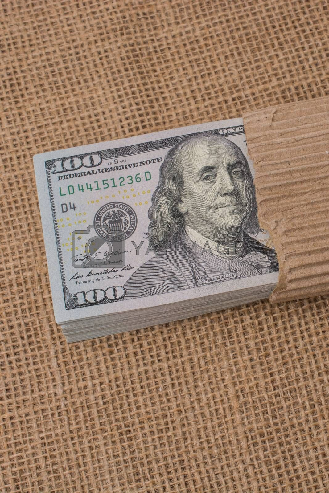 Banknote bundle of US dollar placed on a linen canvas