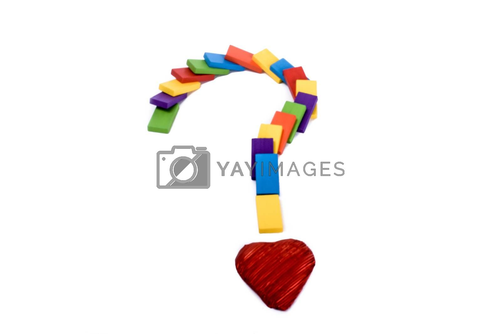 Question mark with colored wooden dominos pieces and a heart
