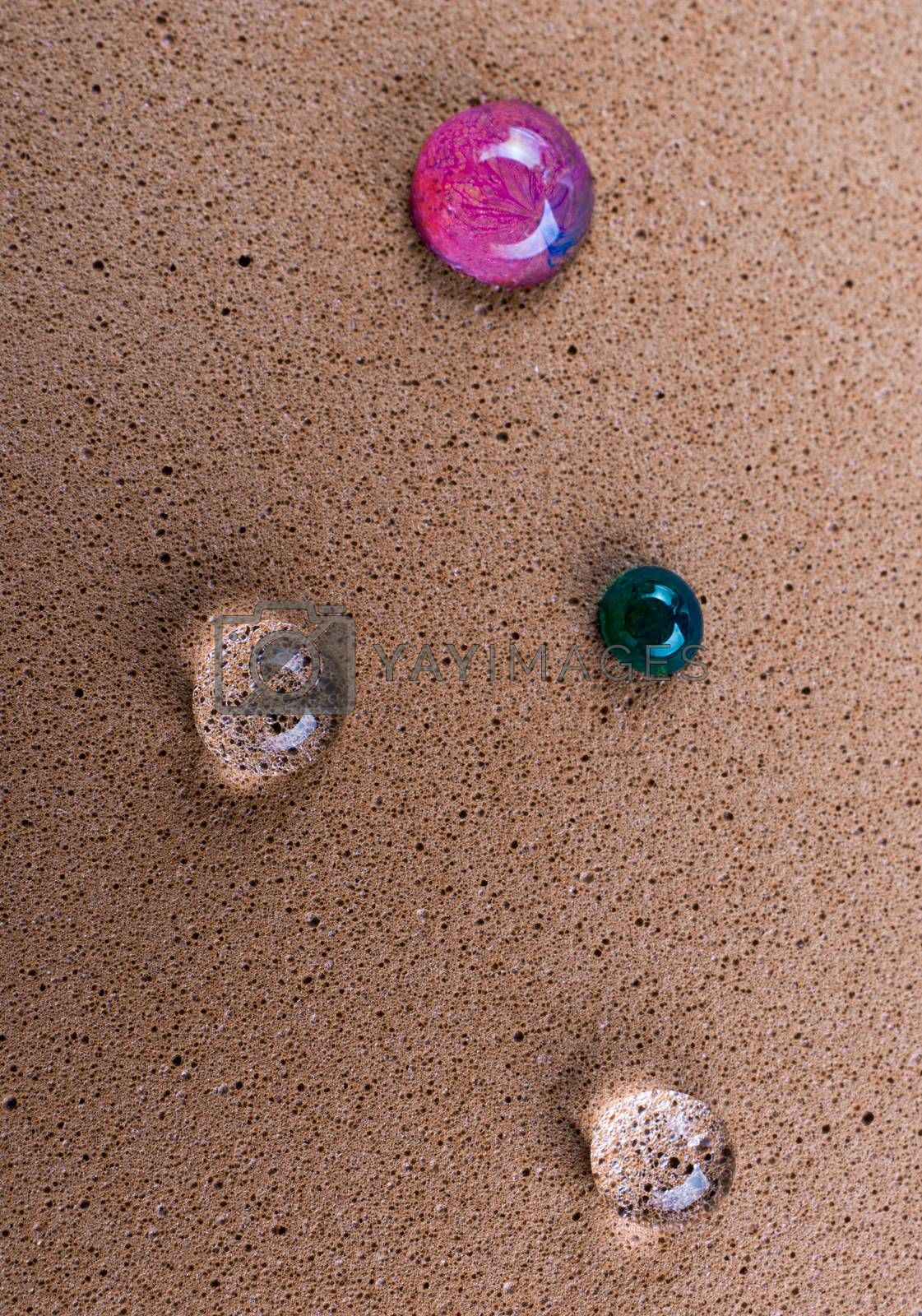 Background covered with colorful water drops in  close-up view