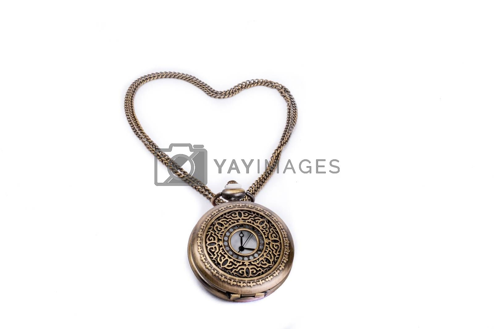 Retro styled pocket watch and its chain form a heart on a white background