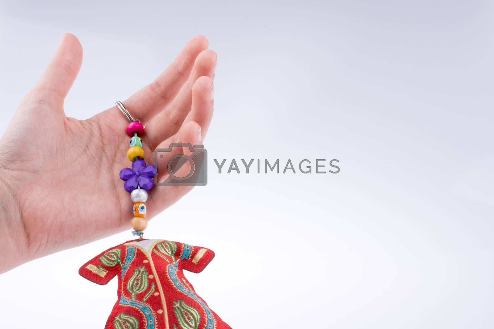 Hand holding traditional clothes with ornaments