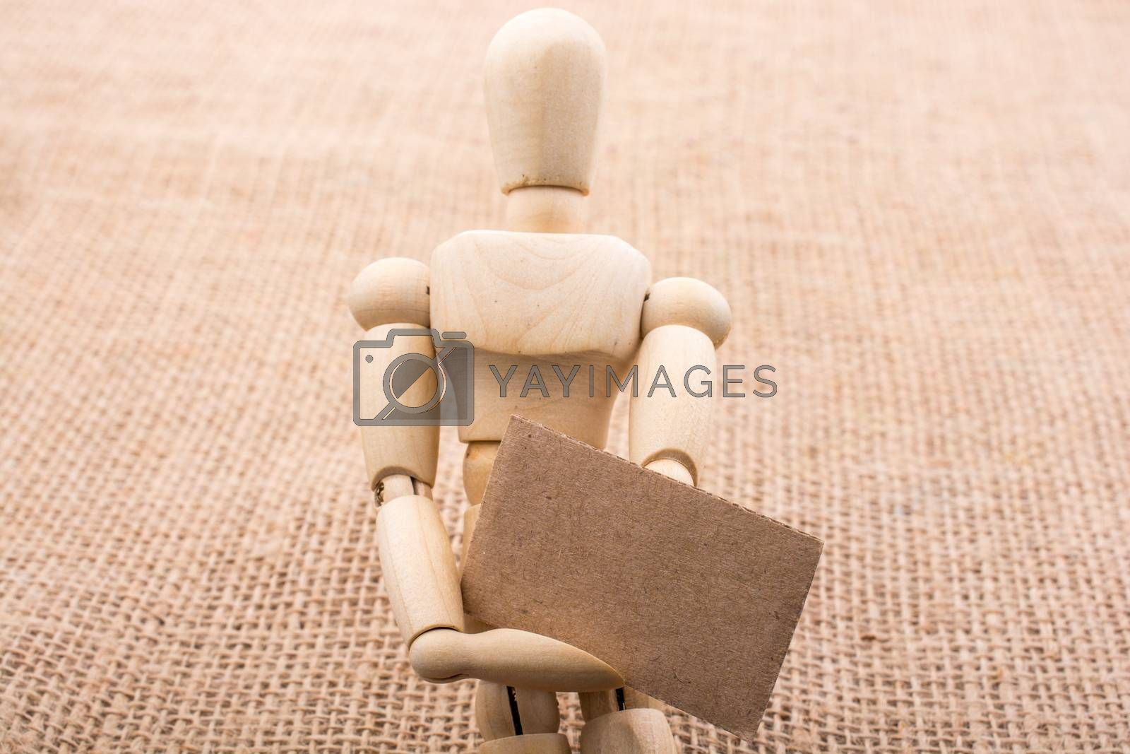 Wooden dolls posing with a noticeboard on canvas