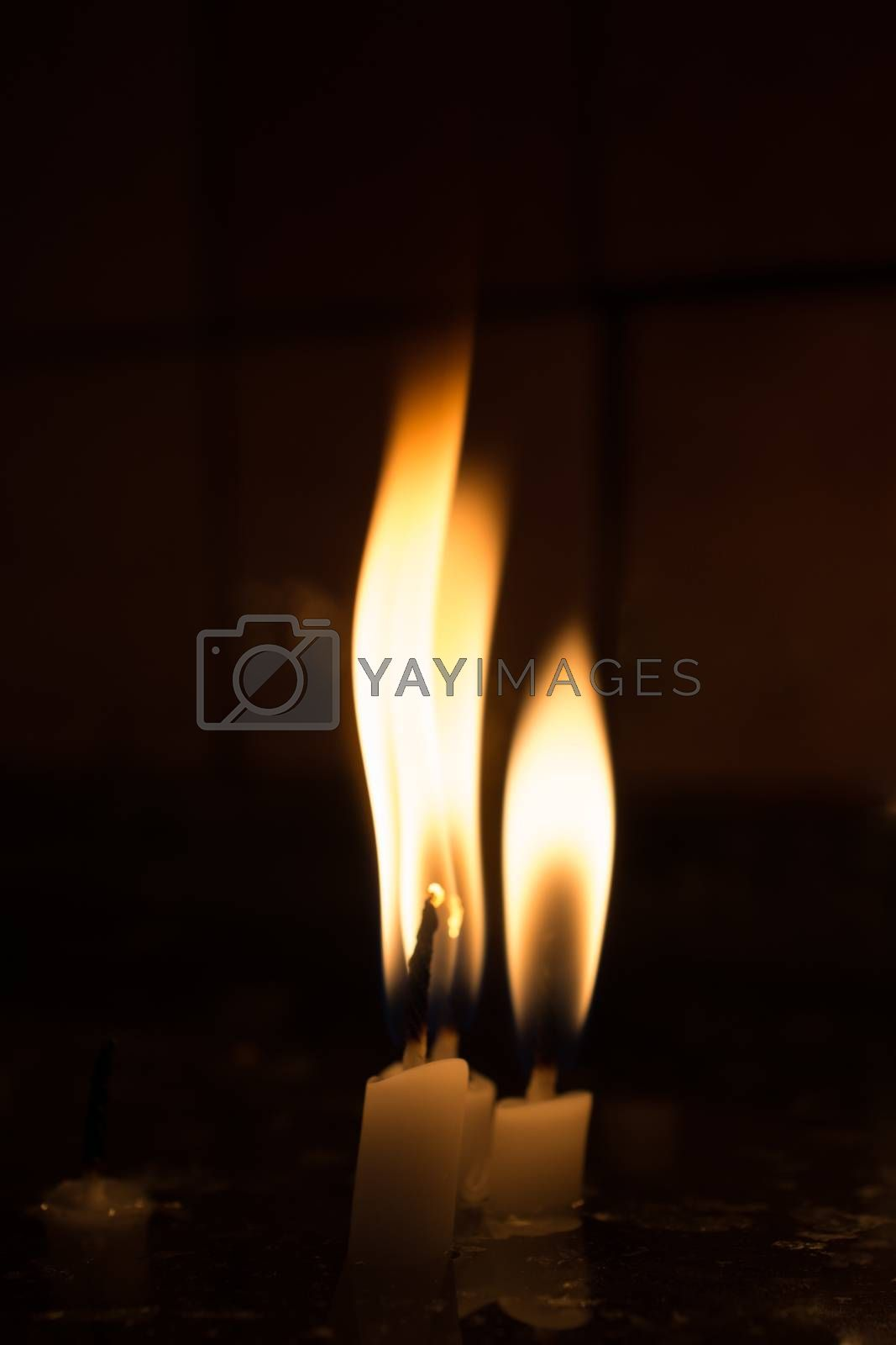 Burning candles with candle light in the dark