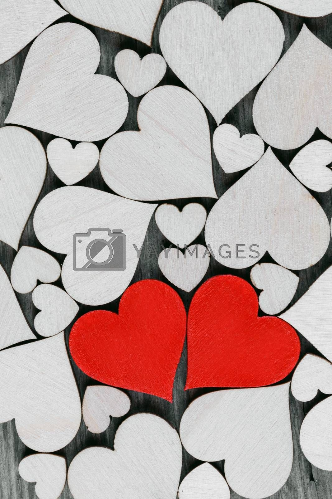 Vintage style of 2 red hearts with wooden hearts background . Happy Valentine's Day concept .