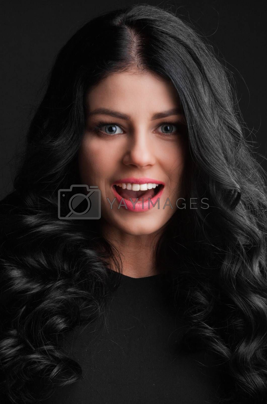 Portrait of a beautiful surprised young woman . open mouth . holiday gift Valentine day concept