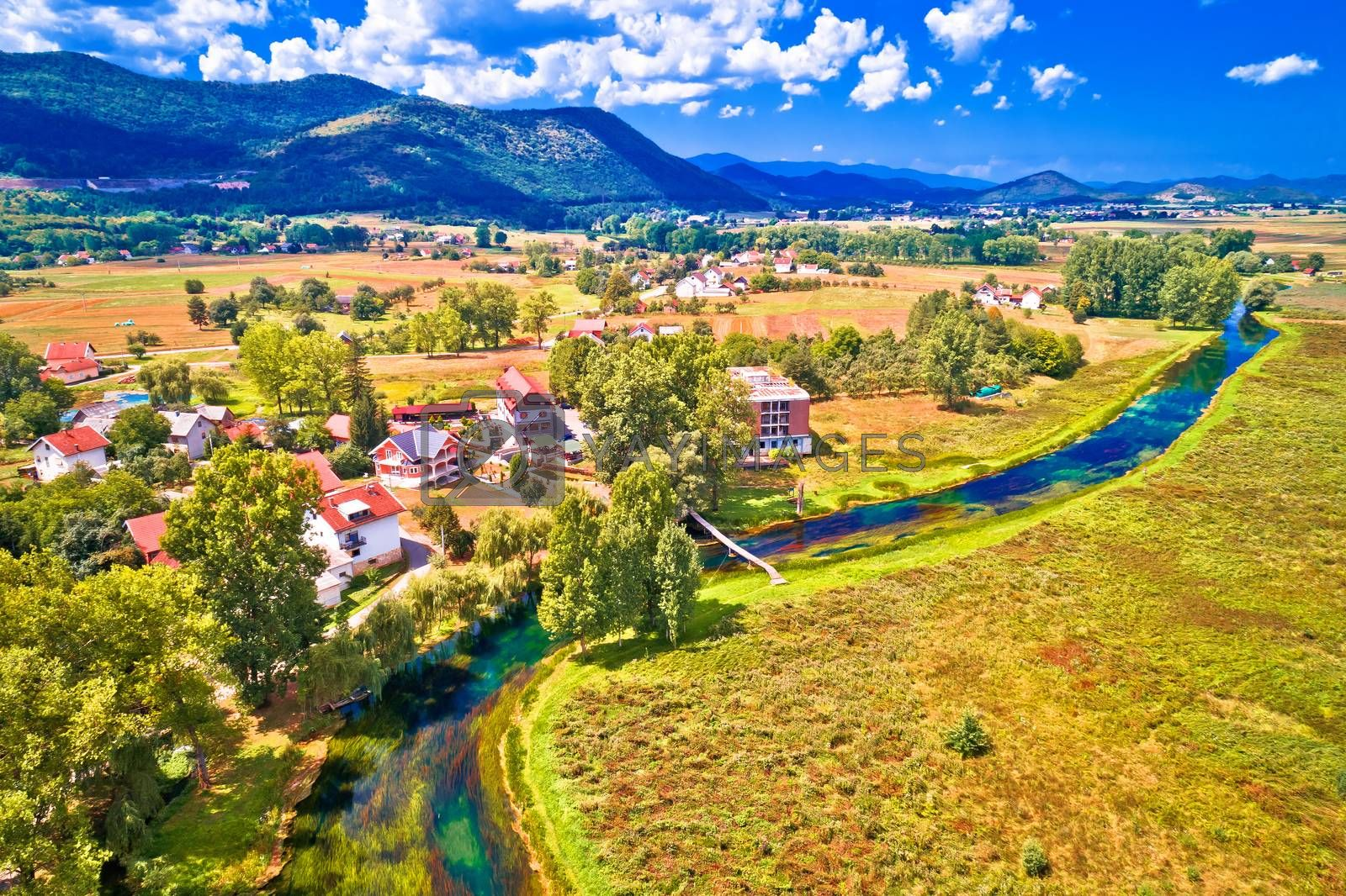 Colorful Gacka valley field and river aerial summer view, Lika region of Croatia