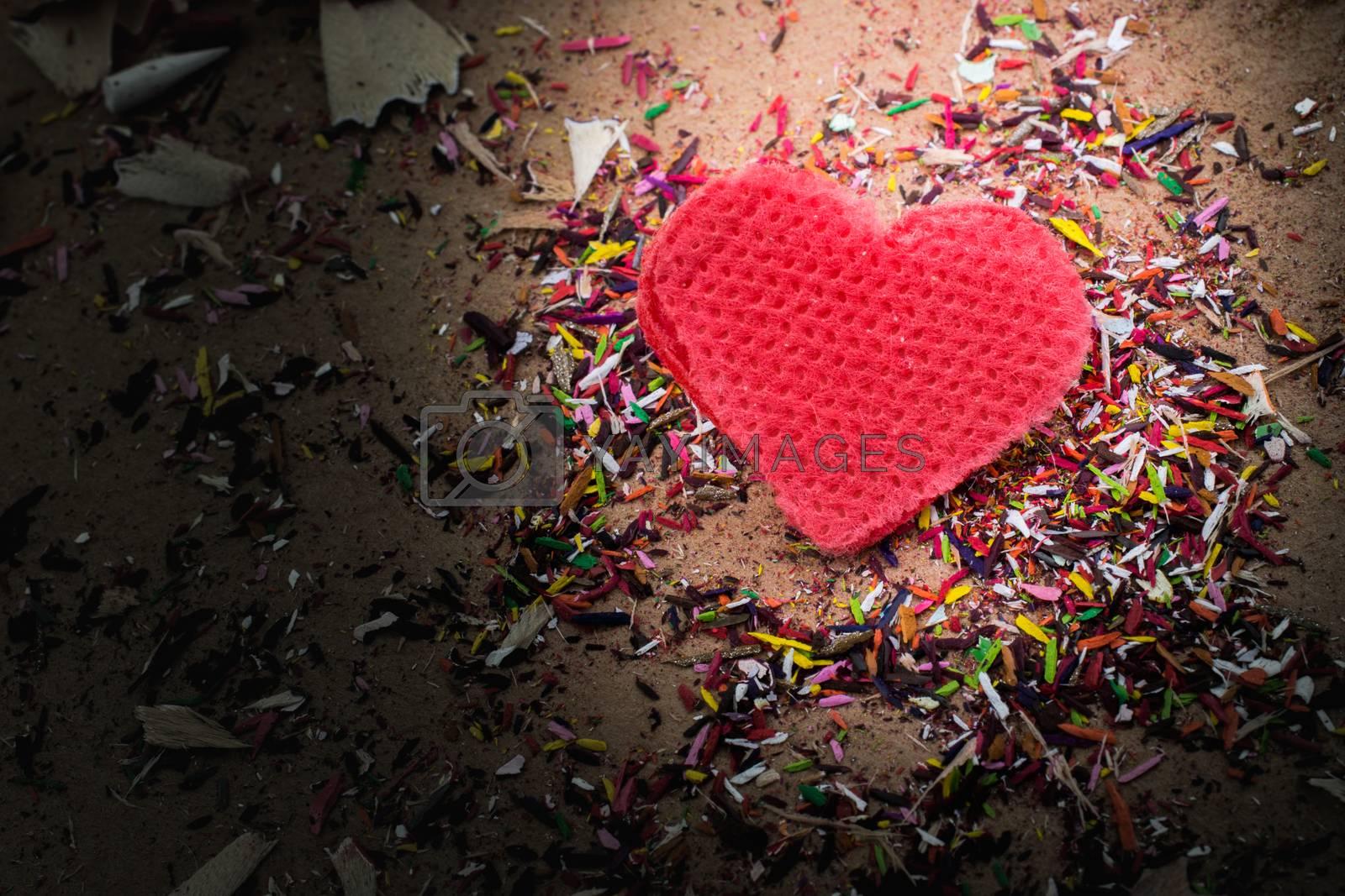 Heart shaped object amid pencil shavings