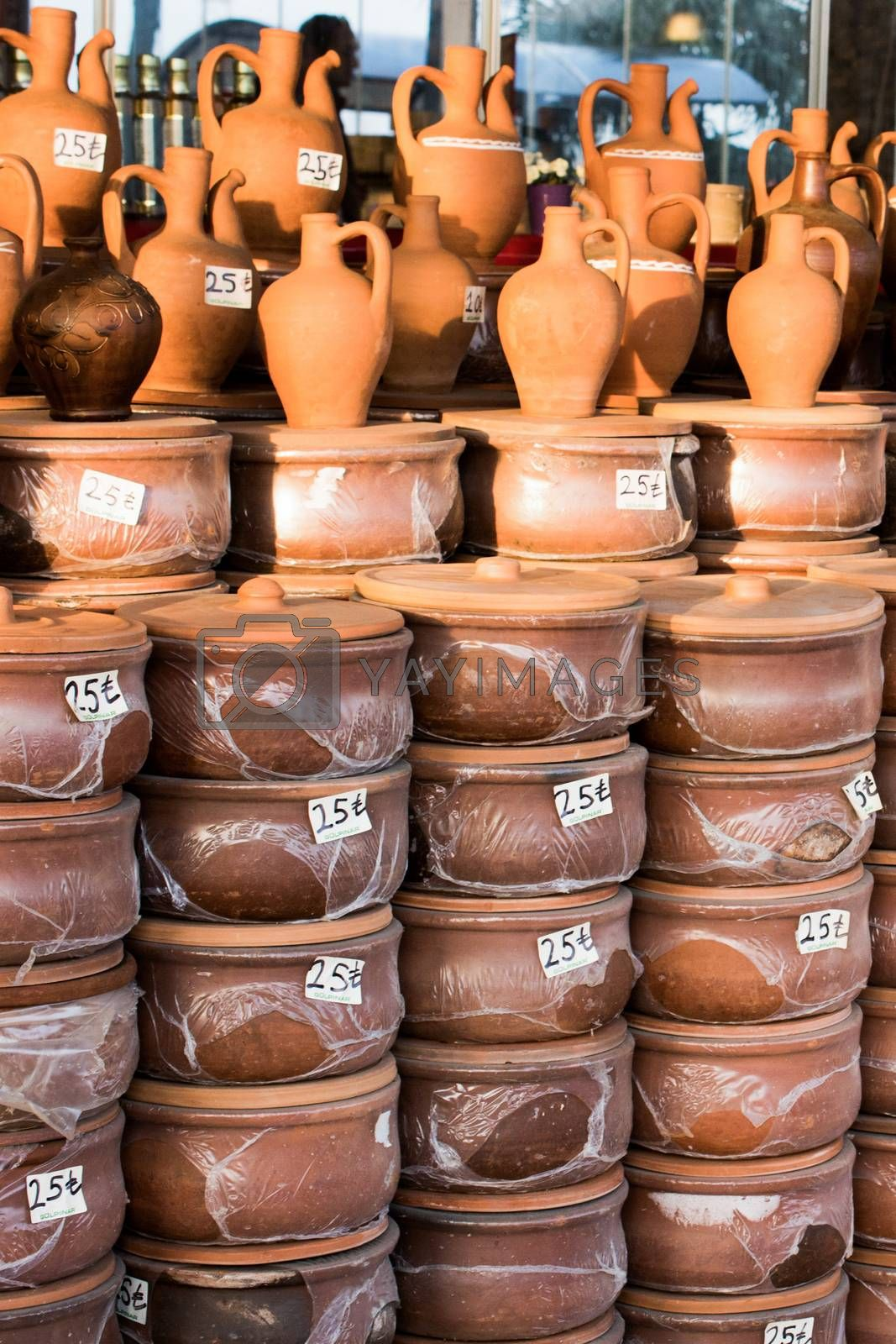 Harden clay pot showing for sale in a market
