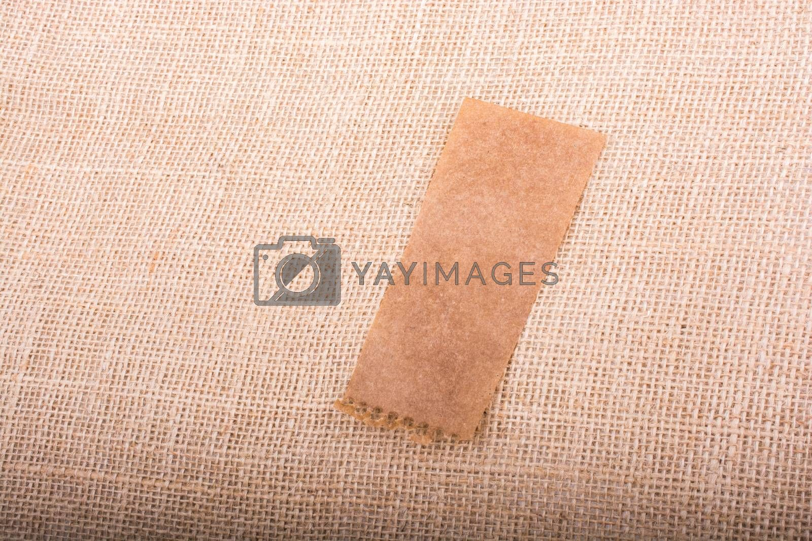 Piece of brown paper on a wooden background